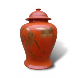 Lovely coral colored temple jar with gilt crane motif
